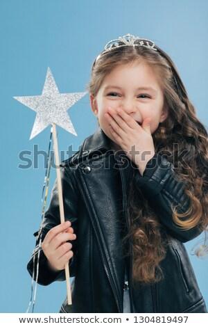 Positivo pequeno criança boca um palma Foto stock © vkstudio