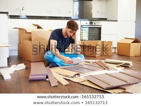 Frustrated Man Putting Together Self Assembly Furniture Stock photo © galitskaya