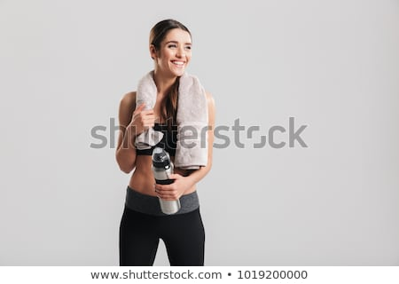 Image of young brunette woman in sportswear looking aside at cop Stock photo © deandrobot