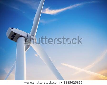 wind turbine generating electricity on blue sky  Stock photo © meinzahn