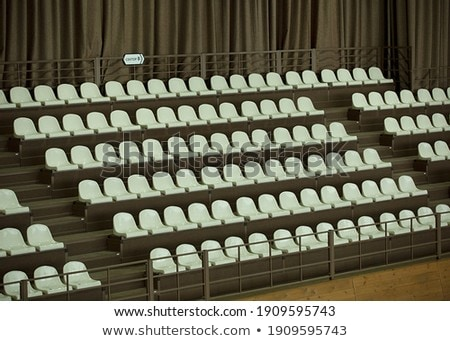 sector of the stadium with the inscription a with blue chairs stock photo © alisluch