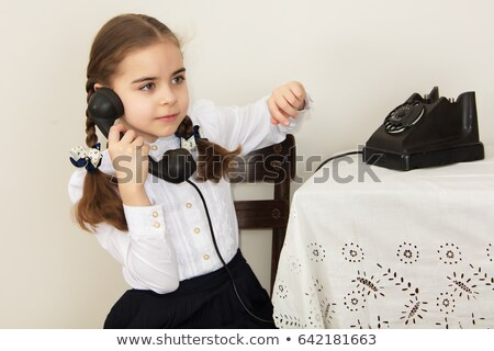 Portrait of little girl sitting with retro phone. Interior in retro style. Vertical format. Stock photo © Paha_L