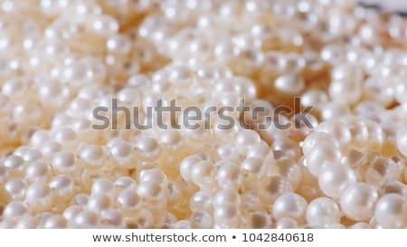 White beads at pink background Stock photo © DedMorozz
