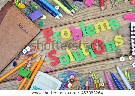 problems solutions words and office tools on wooden table stock photo © fuzzbones0