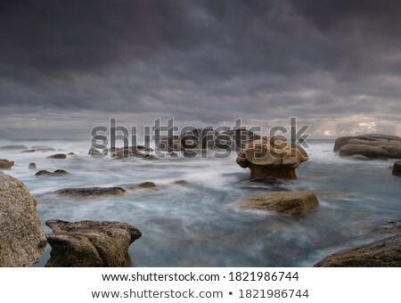 rocky shoreline stock photo © t3mujin