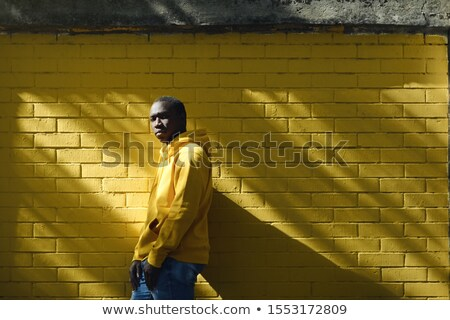 African Male Immigrant Looks At Camera With Serious Expression Stock photo © diego_cervo