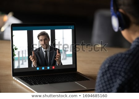 Człowiek za pomocą laptopa pc zdalnego rozmowy wideo Zdjęcia stock © choreograph