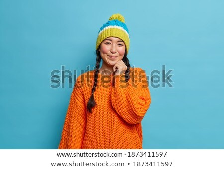 Shy woman wearing hat and jumper stock photo © photography33