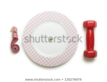 Plate with one peas. Dumbbell and centimeter measure.  Stock photo © deyangeorgiev