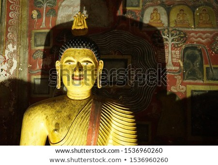 religious paintings inside of rock temple in dambulla stock photo © meinzahn