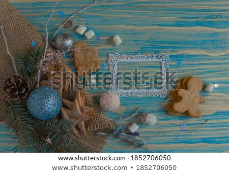 Wooden background with cookies and christmassy spices Stock photo © Zerbor