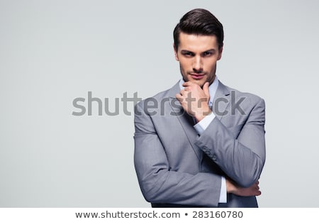 Affaires toucher menton blanche costume Photo stock © wavebreak_media