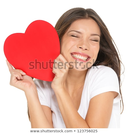Stock photo: Cute young woman holding red heart
