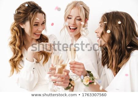 beautiful blonde woman drinking champagne stock photo © neonshot