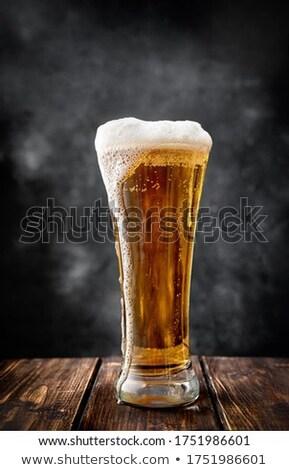 Cam soğuk bira köpük siyah arka plan Stok fotoğraf © stokato