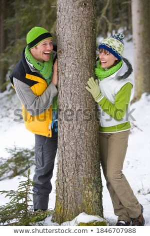 Side view of couple playing on tree trunk Stock photo © wavebreak_media