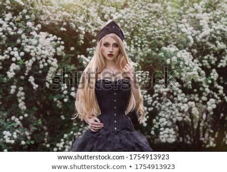 Model in black wearing kokoshnik Stock photo © julenochek