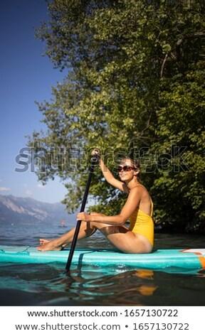 csinos · fiatal · nő · beszállás · tó · áll · felfelé - stock fotó © lightpoet