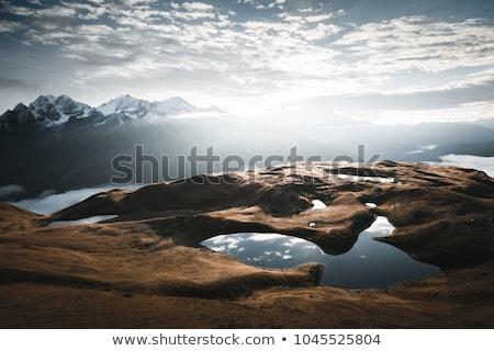 Mountainous landscape of Svaneti with peak Ushba in the clouds Stock photo © Kotenko