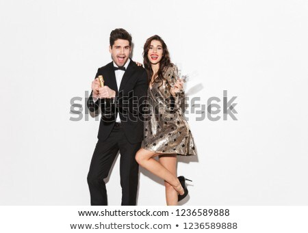 Cheerful young smartly dressed celebrating New Year Stock photo © deandrobot