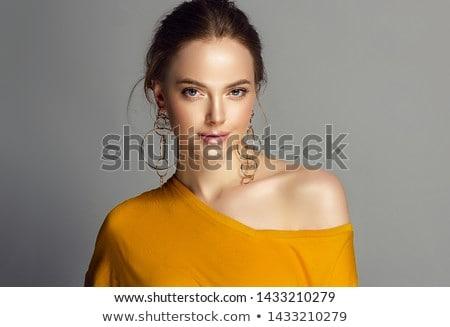 Make-up produtos jovem beautiful girl ouro brincos Foto stock © serdechny