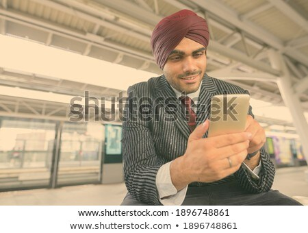 Low angle view of young Asian businessman smiling while using mobile phone during business seminar i Stock photo © wavebreak_media