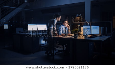 businesswoman working on computer at night office Stock photo © dolgachov