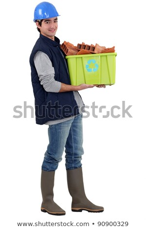 Young tradesman taking out the recycling Stock photo © photography33