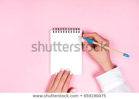 blue paper in woman hand stock photo © taigi