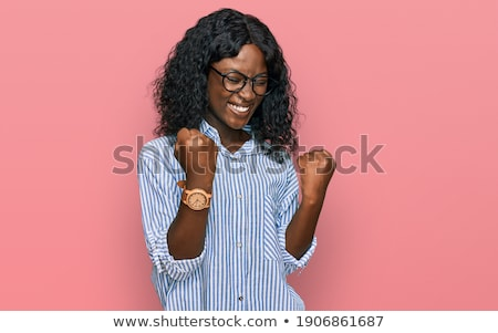 Portrait of smiling woman wearing casual clothes. Positive and f Stock photo © HASLOO