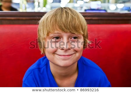smart boy sitting by night in a diners stock photo © meinzahn