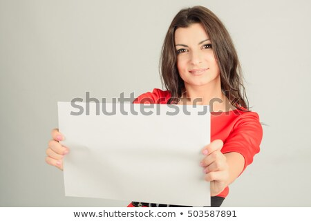 Portrait of beautiful woman in black dress on gray background Stock photo © deandrobot