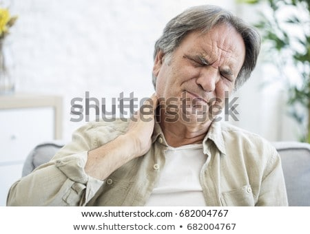 Senior man with a neck pain. Stock photo © Kurhan