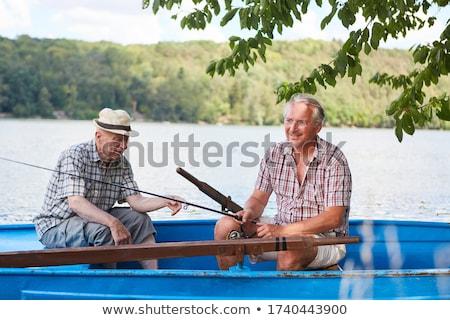 Man vissen roeiboot natuur zomer boot Stockfoto © IS2