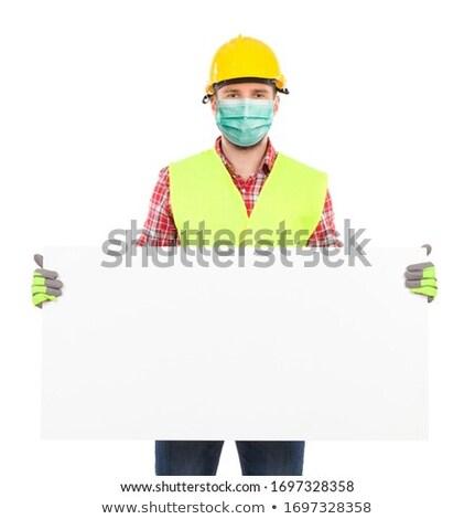 Munkás tart tábla építőmunkás fehér tábla kéz Stock fotó © CsDeli