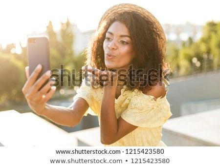 Foto amerikaanse vrouw 20s Stockfoto © deandrobot