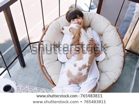 Meisje kussen witte puppy armen vrouw Stockfoto © ElenaBatkova