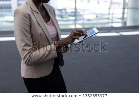 Mid section of young African-American female architect using digital tablet in modern office Stock photo © wavebreak_media