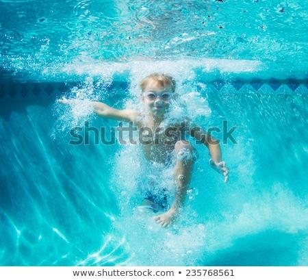 fiú · jókedv · úszik · szörf · tábla · medence - stock fotó © meinzahn