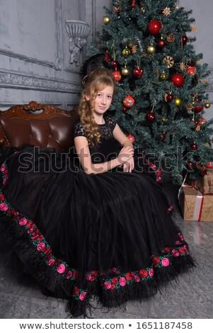 Gyönyörű szőke lány fekete estélyi ruha kéz Stock fotó © Nejron