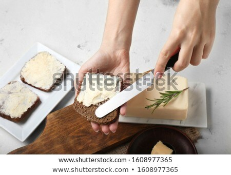 Spreading butter on bread Stock photo © gemenacom