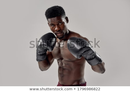 Torse nu boxeur noir musculaire regardant vers le bas sport Photo stock © wavebreak_media