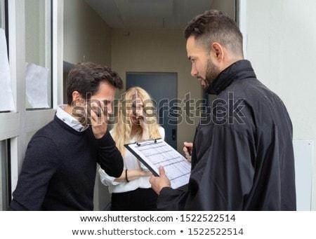 Bailiff Talking With Sad Couple Stock photo © AndreyPopov