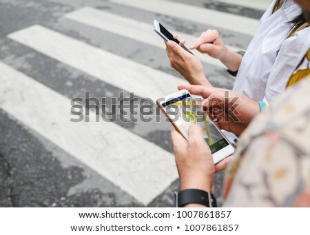 Woman Tourist using navigation app on the mobile phone. Navigation map on a smartphone in a big city Stock photo © galitskaya