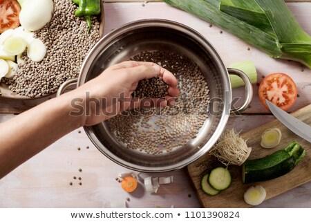 man preparing a vegetarian lentil stew Stock photo © nito