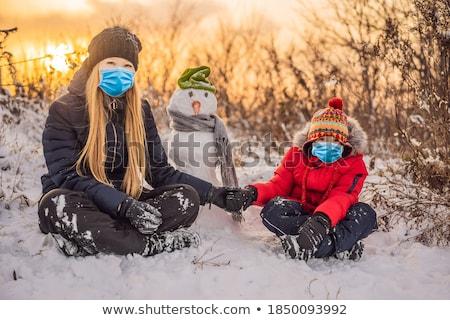 Famille heureuse vêtements chauds souriant mère fils Photo stock © galitskaya