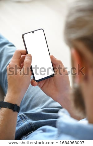 Hand holding smartphone with playing video on screen. Social network and mobile device. Graphics for Stock photo © designer_things