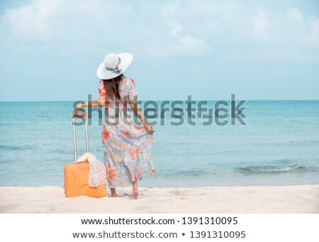 Woman holding her suitcase Stock photo © photography33