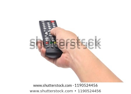 Hand holding TV remote control isolated on white background stock photo © pinkblue