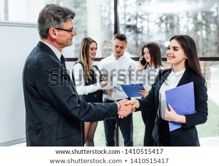 Stock photo: Man with folder offering to shake hands